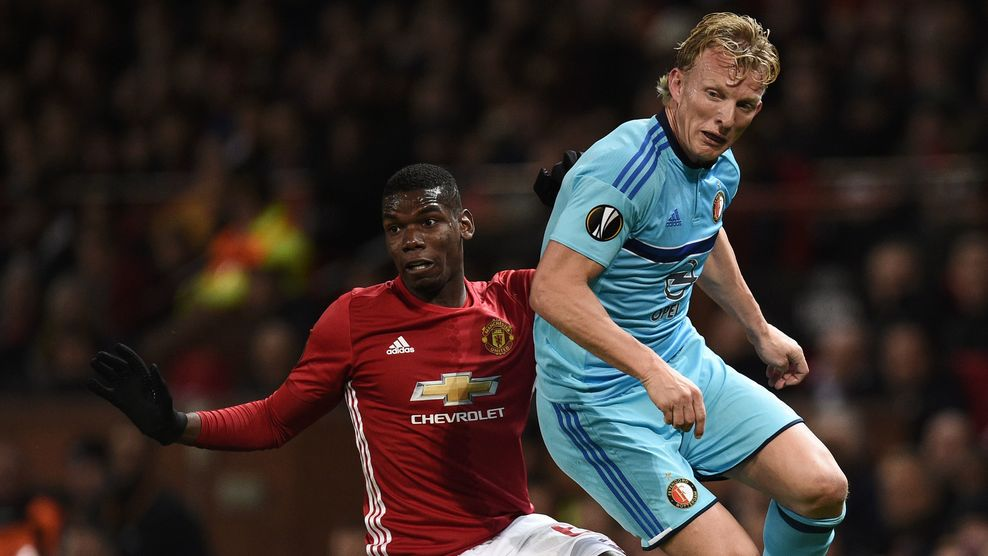 Manchester United's French midfielder Paul Pogba (L) holds off Feyenoord's Dutch striker Dirk Kuyt (R) during the UEFA Europa League group A football match between Manchester United and Feyenoord at Old Trafford stadium in Manchester, north-west England, on November 24, 2016. / AFP / Oli SCARFF (Photo credit should read OLI SCARFF/AFP/Getty Images)